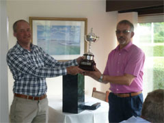 John presents the trophy to Graham and congratulates him on a resounding victory