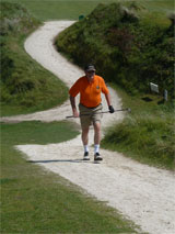 Phil Latham strides back to the 2nd tee after losing his ball
